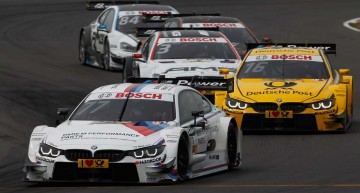 Lausitzring (DE) 31th May 2015. BMW Motorsport,  Race 04, Martin Tomczyk (DE) BMW M Performance Parts M4 DTM and Timo Glock (DE) DEUTSCHE POST BMW M4 DTM. This image is copyright free for editorial use © BMW AG (05/2015).